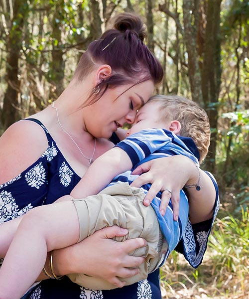 Helen cradling her son Archie